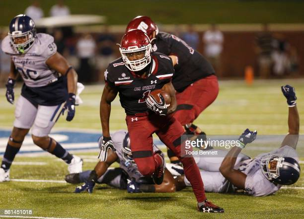 Running back Jason Huntley of the New Mexico State Aggies tries to elude defenders from the Georgia Southern Eagles at Paulson Stadium on October 14...