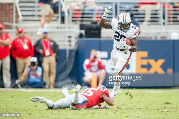 Running back JaTarvious Whitlow of the Auburn Tigers escapes a tackle by defensive back Myles Hartsfield of the Mississippi Rebels during the second...
