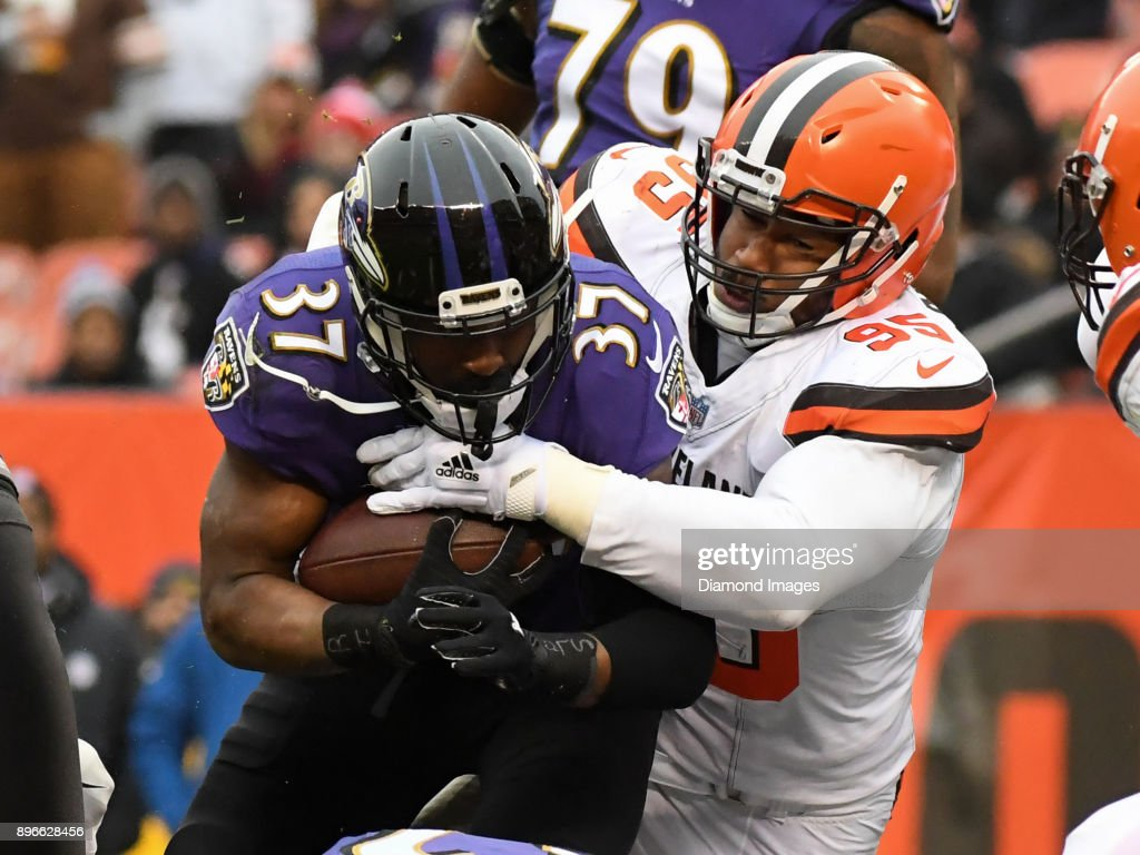 Running back Javorius Allen #37 of the Baltimore Ravens is tackled by defensive end Myles Garrett #95 of the Cleveland Browns in the second quarter of a game on December 17, 2017 at FirstEnergy Stadium in Cleveland, Ohio. Baltimore won 27-10.