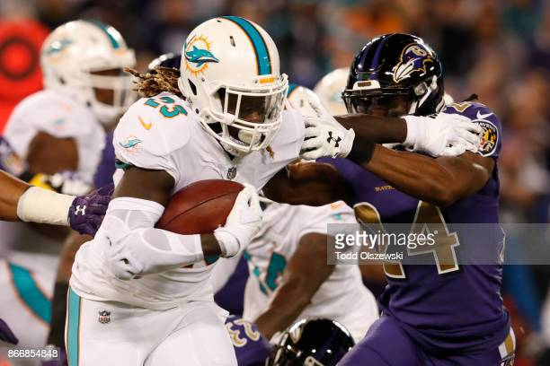 Running Back Jay Ajayi of the Miami Dolphins carries the ball in the first quarter against the Baltimore Ravens at MT Bank Stadium on October 26 2017...
