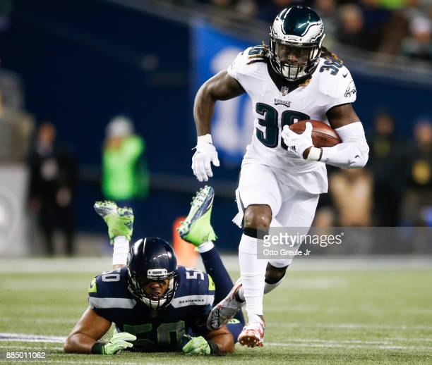 Running back Jay Ajayi of the Philadelphia Eagles breaks a tackle by linebacker KJ Wright of the Seattle Seahawks in the second quarter at...