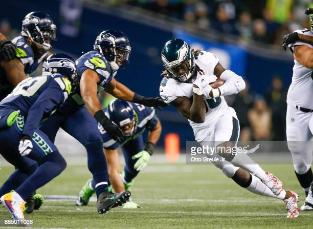 Running back Jay Ajayi of the Philadelphia Eagles rushes against middle linebacker Bobby Wagner of the Seattle Seahawks in the second quarter at...