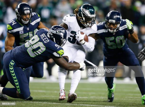 Running back Jay Ajayi of the Philadelphia Eagles rushes against defensive tackle Jarran Reed of the Seattle Seahawks and KJ Wright at CenturyLink...