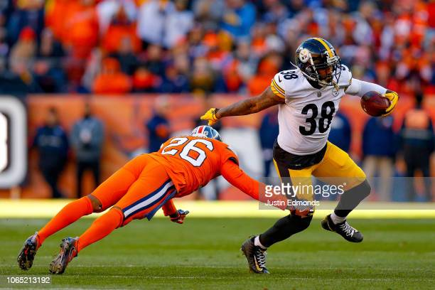 Running back Jaylen Samuels of the Pittsburgh Steelers avoids a tackle attempt by strong safety Darian Stewart of the Denver Broncos in the first...