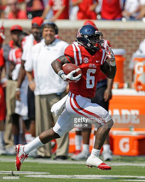 Running back Jaylen Walton of the Mississippi Rebels carries the ball for a touchdown during the first quarter of a NCAA college football game...