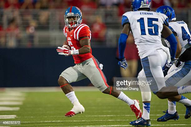 Running back Jaylen Walton of the Mississippi Rebels runs the ball downfield during their game against the Memphis Tigers on September 27 2014 at...