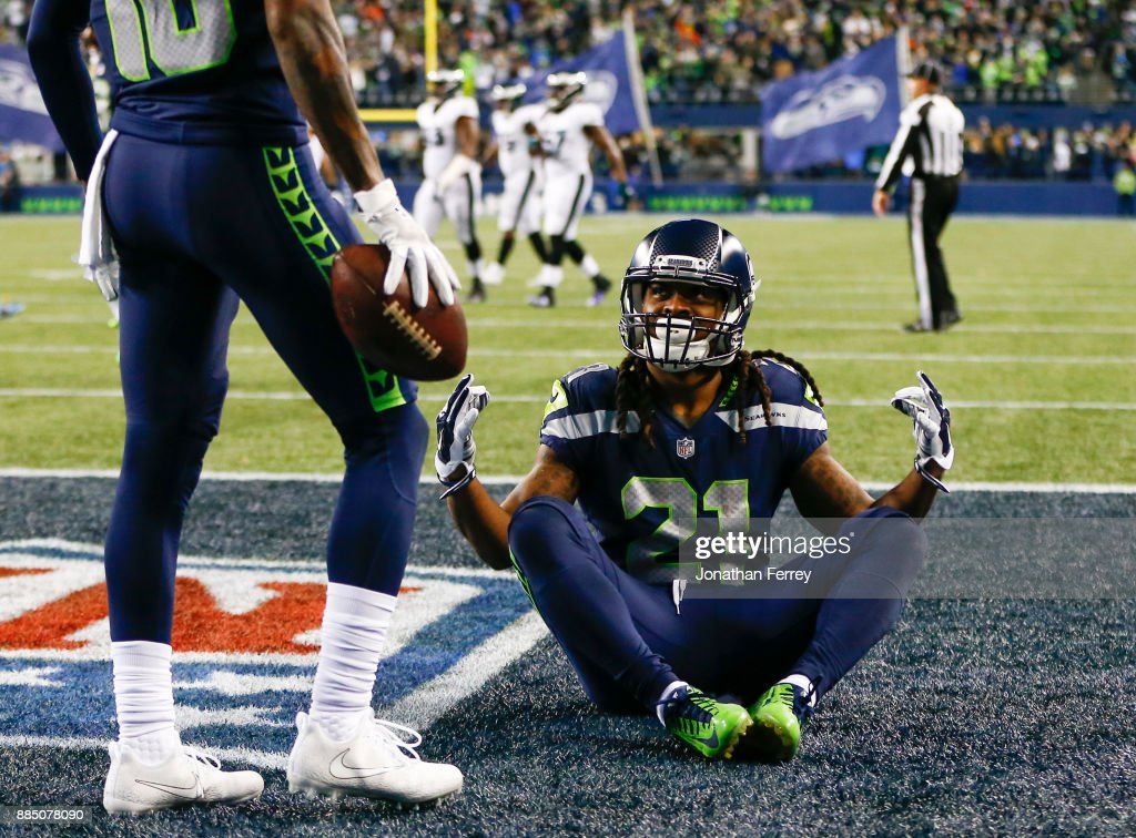 Running back J.D. McKissic #21 of the Seattle Seahawks celebrates his 15 yard touchdown against the Philadelphia Eagles in the fourth quarter at CenturyLink Field on December 3, 2017 in Seattle, Washington.