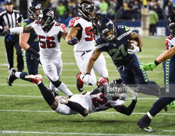Running back JD McKissic of the Seattle Seahawks rushes against free safety Damontae Kazee of the Atlanta Falcons during the game at CenturyLink...