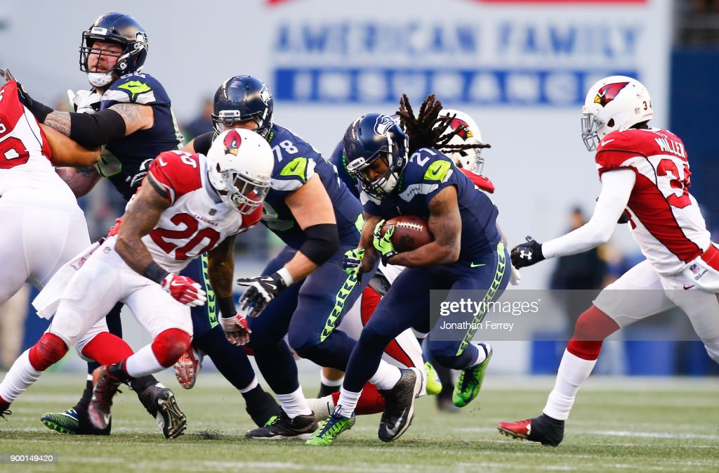 Running back J.D. McKissic #21 of the Seattle Seahawks rushes in the third quarter against the Arizona Cardinals at CenturyLink Field on December 31, 2017 in Seattle, Washington.