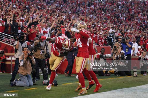 Running back Jeff Wilson Jr. #30 of the San Francisco 49ers celebrates alongside wide receiver Kendrick Bourne after scoring on a 25 yrad touchdown...
