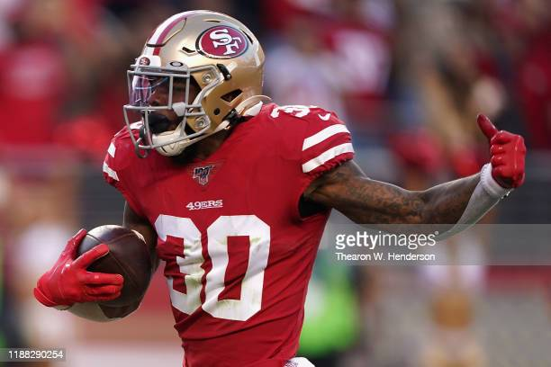 Running back Jeff Wilson Jr #30 of the San Francisco 49ers scores on a 25 yrad touchdown reception against the Arizona Cardinals during the second...
