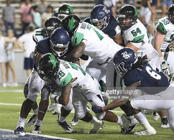 Running back Jeffrey Wilson of the North Texas Mean Green rushes for a touchdown in overtime against the Rice Owls at Rice Stadium on September 24...