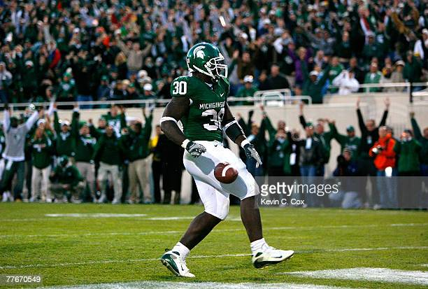Running back Jehuu Caulcrick of the Michigan State Spartans celebrates his touchdown during the second half against the Michigan Wolverines at...