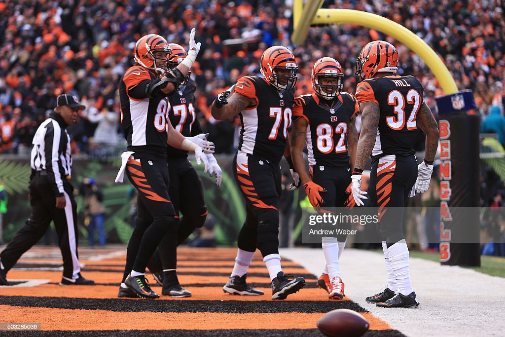 Running back Jeremy Hill #32 of the Cincinnati Bengals celebrates after scoring touchdown during the third quarter against the Baltimore Ravens at Paul Brown Stadium on January 3, 2016 in Cincinnati, Ohio.