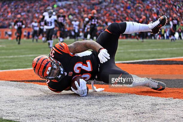 Running back Jeremy Hill of the Cincinnati Bengals dives into the endzone for a touchdown during the third quarter against the Baltimore Ravens at...