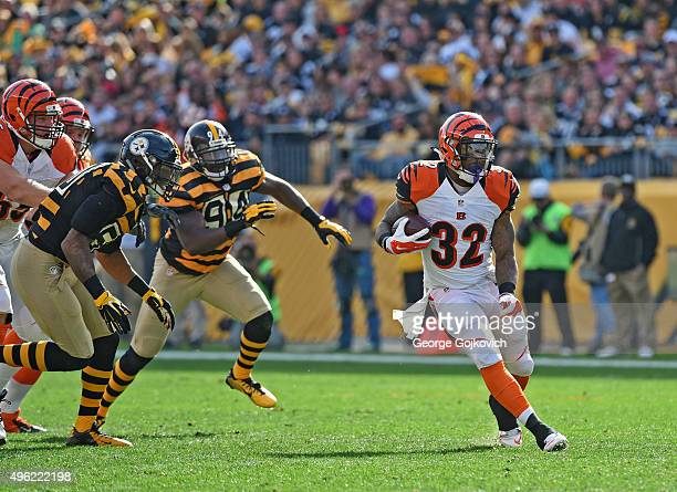 Running back Jeremy Hill of the Cincinnati Bengals is pursued by linebackers Ryan Shazier and Lawrence Timmons of the Pittsburgh Steelers as he runs...