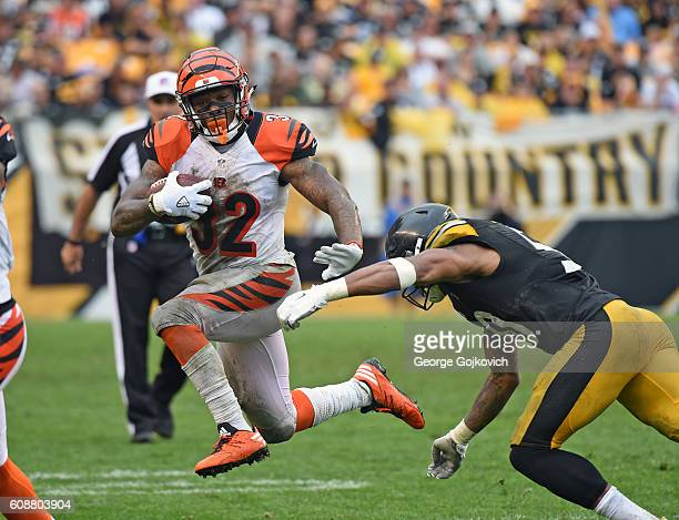 Running back Jeremy Hill of the Cincinnati Bengals runs from linebacker Ryan Shazier of the Pittsburgh Steelers during a game at Heinz Field on...