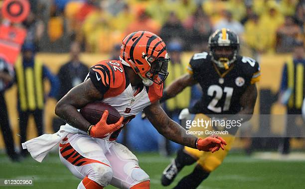 Running back Jeremy Hill of the Cincinnati Bengals runs with the football as rain falls during a game against the Pittsburgh Steelers at Heinz Field...