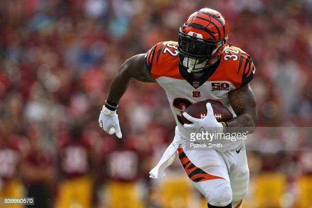 Running back Jeremy Hill of the Cincinnati Bengals rushes against the Washington Redskins in the first half during a preseason game at FedExField on...