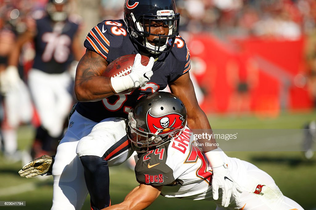 Running back Jeremy Langford #33 of the Chicago Bears is stopped by cornerback Brent Grimes #24 of the Tampa Bay Buccaneers during a carry in the third quarter of an NFL game on November 13, 2016 at Raymond James Stadium in Tampa, Florida.