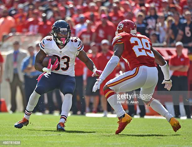 Running back Jeremy Langford of the Chicago Bears rushes up field against safety Eric Berry of the Kansas City Chiefs during the first half at...
