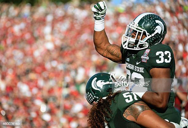 Running back Jeremy Langford of the Michigan State Spartans celebrates a two yard touchdown run against the Stanford Cardinal in the second quarter...