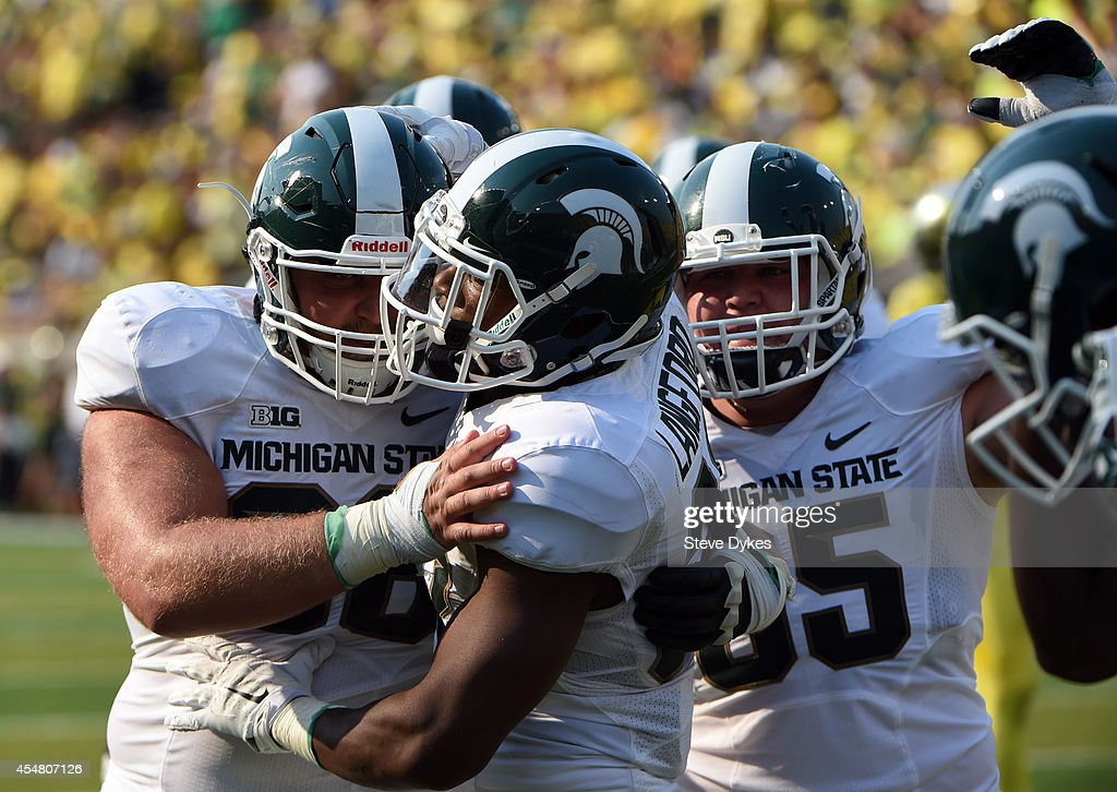 Running back Jeremy Langford #33 of the Michigan State Spartans celebrates after scoring a touchdown during the second quarter of the game against the Oregon Ducks at Autzen Stadium on September 6, 2014 in Eugene, Oregon.