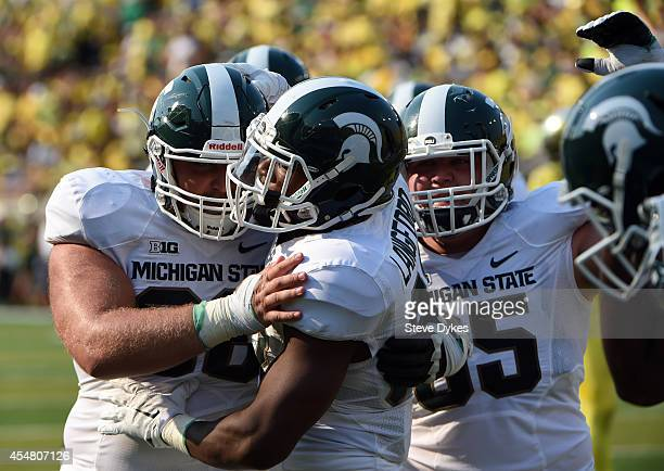 Running back Jeremy Langford of the Michigan State Spartans celebrates after scoring a touchdown during the second quarter of the game against the...