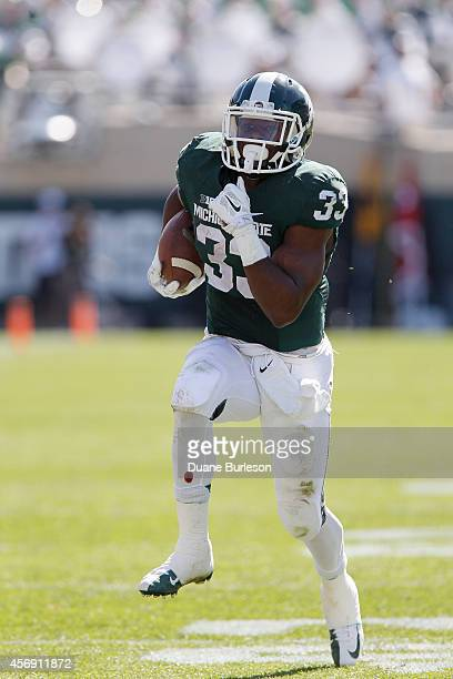 Running back Jeremy Langford of the Michigan State Spartans carries against the Wyoming Cowboys Spartan Stadium on September 27 in East Lansing,...