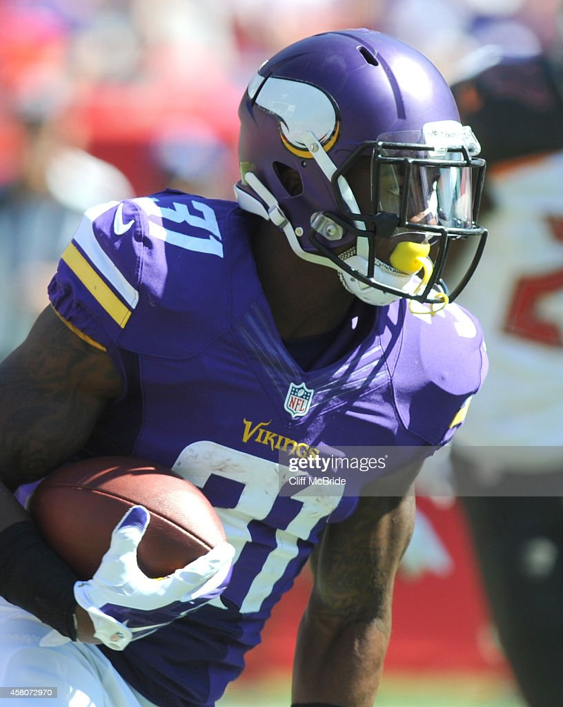 Running back Jerick McKinnon #31 of the Minnesota Vikings carries the ball against the Tampa Bay Buccaneers at Raymond James Stadium on October 26, 2014 in Tampa, Florida.