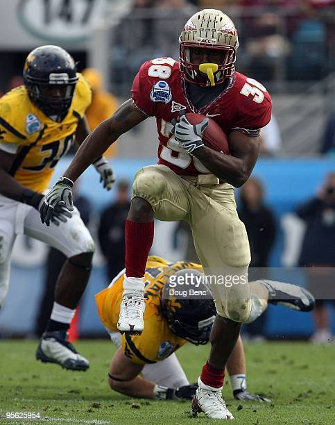 Running back Jermaine Thomas of the Florida State Seminoles looks for room to run against the West Virginia Mountaineers during the Konica Minolta...