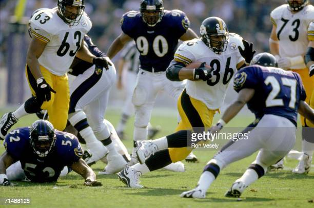 Running back Jerome Bettis of the Pittsburgh Steelers carries the ball against the Baltimore Ravens at Memorial Stadium on October 5 1997 in...