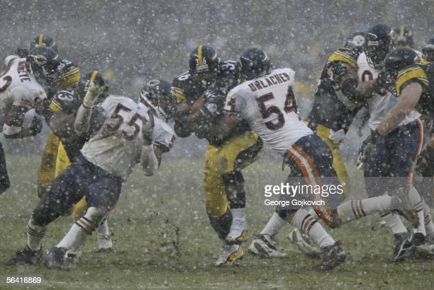 Running back Jerome Bettis of the Pittsburgh Steelers runs the ball against linebackers Brian Urlacher and Lance Briggs of the Chicago Bears as snow...
