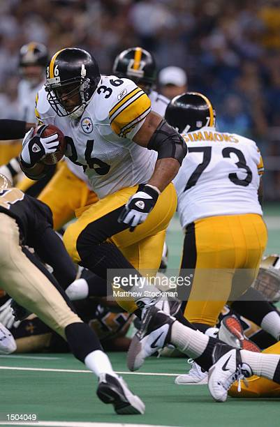 Running back Jerome Bettis of the Pittsburgh Steelers runs with the ball during the NFL game against the New Orleans Saints on October 6 2002 at the...