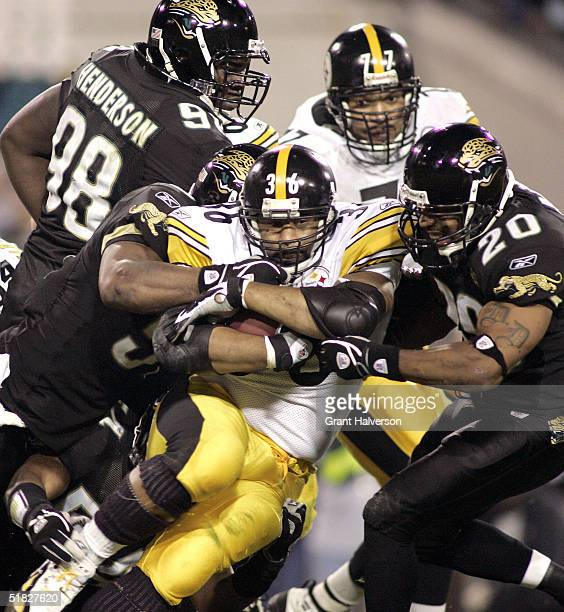 Running back Jerome Bettis of the Pittsburgh Steelers rushes against safety Donovin Darius of the Jacksonville Jaguars at Alltel Stadium on December...