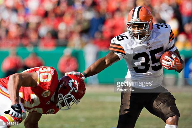 Running back Jerome Harrison of the Cleveland Browns stiff arms safety Mike Brown of the Kansas City Chiefs at Arrowhead Stadium on December 20 2009...