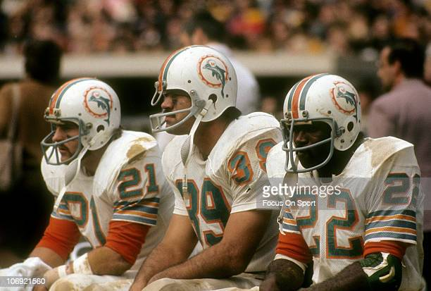 Running back Jim Kiick Larry Csonka and Mercury Morris of the Miami Dolphins watching the action from the bench during an NFL football game circa...