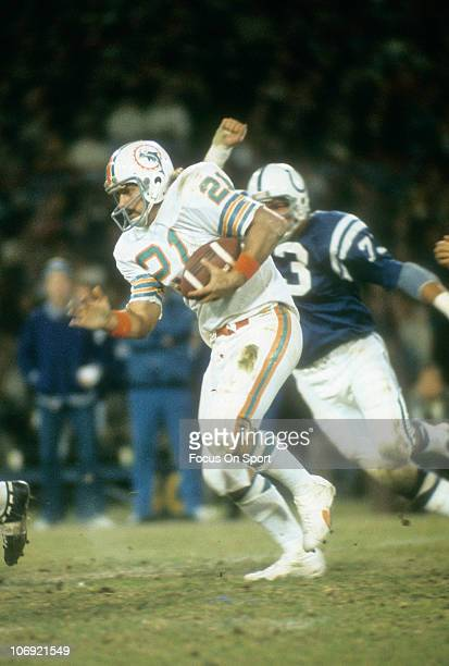Running back Jim Kiick of the Miami Dolphins carries the ball against the Baltimore Colts during an NFL football game at Memorial Stadium circa 1972...
