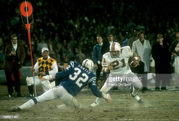 Running back Jim Kiick of the Miami Dolphins puts a move on Mike Curtis of the Baltimore Colts during an NFL football game at Memorial Stadium circa...