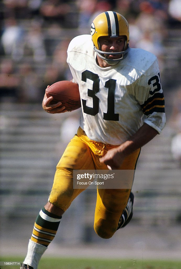 Running back Jim Taylor #31 of the Green Bay Packers carries the ball during an NFL football game circa 1965. Taylor played for the Packers from 1958-66.