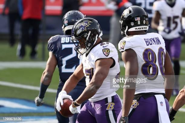 Running back J.K. Dobbins of the Baltimore Ravens celebrates following his 4-yard touchdown run during the third quarter of their AFC Wild Card...