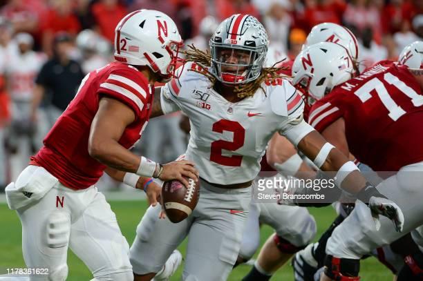 Running back JK Dobbins of the Ohio State Buckeyes pressures quarterback Adrian Martinez of the Nebraska Cornhuskers at Memorial Stadium on September...