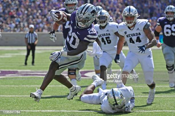 Running back Joe Ervin of the Kansas State Wildcats runs for a touchdown against safety JoJuan Claiborne of the Nevada Wolf Pack during the first...