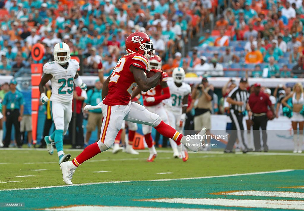 Running back Joe McKnight #22 of the Kansas City Chiefs scores a third-quarter touchdown against the Miami Dolphins at Sun Life Stadium on September 21, 2014 in Miami Gardens, Florida.