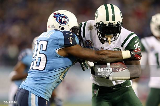 Running back Joe McKnight of the New York Jets runs the ball against strong safety Jordan Babineaux of the Tennessee Titans at LP Field on December...