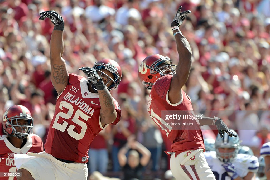 Running back Joe Mixon #25 celebrates after throwing a touchdown pass to wide receiver Dede Westbrook #11 of the Oklahoma Sooners during the first half of their game against the the Kansas State Wildcats on October 15, 2016 at Gaylord Family Oklahoma Memorial Stadium in Norman, Oklahoma.