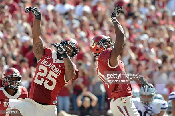 Running back Joe Mixon celebrates after throwing a touchdown pass to wide receiver Dede Westbrook of the Oklahoma Sooners during the first half of...