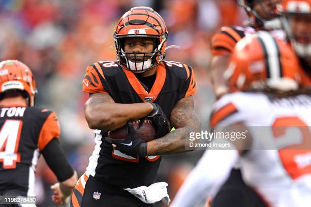 Running back Joe Mixon of the Cincinnati Bengals carries the ball in the fourth quarter of a game against the Cleveland Browns on December 29, 2019...