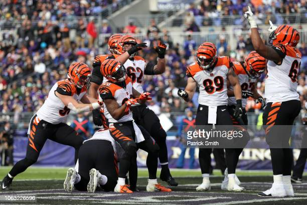 Running Back Joe Mixon of the Cincinnati Bengals celebrates with teammates after a touchdown in the second quarter against the Baltimore Ravens at MT...