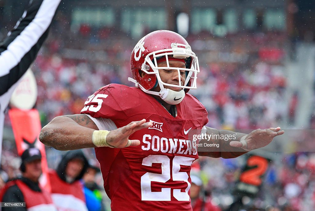 Running back Joe Mixon #25 of the Oklahoma Sooners celebrates a touchdown against the Oklahoma State Cowboys December 3, 2016 at Gaylord Family-Oklahoma Memorial Stadium in Norman, Oklahoma. Oklahoma defeated Oklahoma State 38-20 to become Big XII champions.